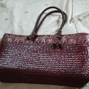Straw tote with fabric band and wooden beaded hand